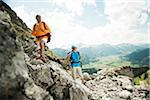 Mature couple hiking in mountains, Tannheim Valley, Austria