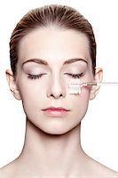 Close-Up of Woman with Eyes Closed Brushing Eyelashes Stock Photo - Premium Rights-Managednull, Code: 700-06826408