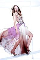 Young Woman Fashion Model Posing in Windblown Dress with Illustrated Embellisments Stock Photo - Premium Rights-Managednull, Code: 700-06826414