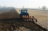 plow - Tractor ploughing the ground of field Stock Photo - Premium Royalty-Freenull, Code: 649-06829521