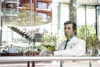 Portrait of male doctor looking out of window Stock Photo - Premium Royalty-Freenull, Code: 649-06829837