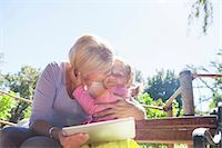 Mother holding laptop and hugging daughter Stock Photo - Premium Royalty-Freenull, Code: 649-06830028