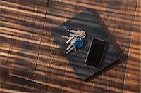 Tablet in case with keys and smartphone on top Stock Photo - Premium Royalty-Freenull, Code: 6106-06830386