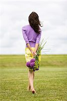 Young woman holding a bouquet of flowers Stock Photo - Premium Rights-Managednull, Code: 877-06832258