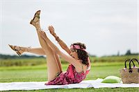 people falling - Young woman taking off her sandals, oudoors Stock Photo - Premium Rights-Managednull, Code: 877-06832310