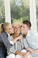 Young couple kissing mature woman Stock Photo - Premium Rights-Managed, Artist: Photononstop, Code: 877-06832449