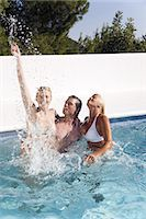 Mature couple and young woman playing in a pool Stock Photo - Premium Rights-Managednull, Code: 877-06832488