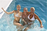 Mature couple and young woman in a pool Stock Photo - Premium Rights-Managednull, Code: 877-06832491