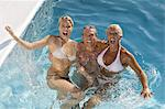 Mature couple and young woman in a pool Stock Photo - Premium Rights-Managed, Artist: Photononstop, Code: 877-06832491
