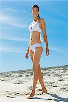 slim - Young woman on the beach, wearing a bathsuit Stock Photo - Premium Rights-Managednull, Code: 877-06833088