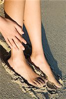 female feet close up - Young woman on the beach, bare feet, close-up Stock Photo - Premium Rights-Managednull, Code: 877-06833231