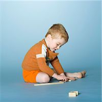 Little boy playing with construction game Stock Photo - Premium Rights-Managednull, Code: 877-06833334