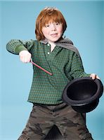 Boy pretending to be a magician Stock Photo - Premium Rights-Managednull, Code: 877-06833390