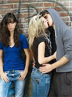 people kissing little boys - Teenagers kissing near teenage girl Stock Photo - Premium Rights-Managednull, Code: 877-06833993
