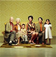 Three generation family sitting in sofa Stock Photo - Premium Rights-Managednull, Code: 877-06834173