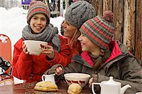 Mother with her children eating outdoors Stock Photo - Premium Rights-Managednull, Code: 877-06834716