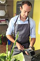 Male florist in his shop Stock Photo - Premium Rights-Managednull, Code: 877-06835640