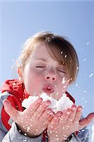 France, winter girl portrait blowing snow Stock Photo - Premium Rights-Managednull, Code: 877-06835760