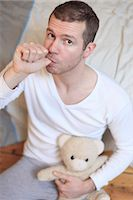 sucking - France man at home.Teddy bear. Stock Photo - Premium Rights-Managednull, Code: 877-06835876
