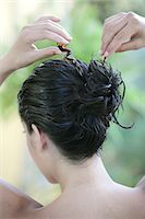Portrait woman tying her long wet brown hair, haircare product Stock Photo - Premium Rights-Managednull, Code: 877-06835915