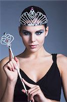 Young woman holding fairy wand, tiara, black dress Stock Photo - Premium Rights-Managednull, Code: 877-06836194