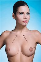 Young woman with presurgical markings on breast and face Stock Photo - Premium Rights-Managednull, Code: 877-06836297