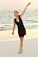 Young woman on the beach Stock Ph