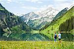 Couple Hiking by Lake, Vilsalpsee, Tannheim Valley, Tyrol, Austria