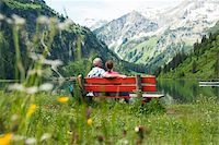 people sitting on bench - Couple Sitting on Bench by Lake, Vilsalpsee, Tannheim Valley, Tyrol, Austria Stock Photo - Premium Royalty-Freenull, Code: 600-06841777