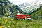 Couple Sitting on Bench by Lake, Vilsalpsee, Tannheim Valley, Tyrol, Austria