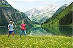 Couple Hiking by Lake, Vilsalpsee, Tannheim Valley, Tyrol, Austria