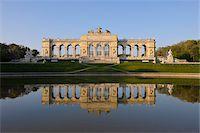 Gloriette reflected in Pond in Garden at Schonbrunn Palace, Vienna, Austria Stock Photo - Premium Royalty-Freenull, Code: 600-06841851