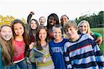 Group portrait of pre-teens standing outdoors, smiling and looking at camera, Florida, USA Stock Photo - Premium Royalty-Free, Artist: Kevin Dodge, Code: 600-06841926