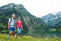 people and vacation - Mature couple hiking in mountains, Lake Vilsalpsee, Tannheim Valley, Austria Stock Photo - Premium Royalty-Freenull, Code: 600-06841945