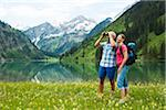 Mature couple hiking in mountains, Lake Vilsalpsee, Tannheim Valley, Austria