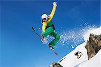 Young female snowboarder jumping Stock Photo - Premium Royalty-Freenull, Code: 649-06844034