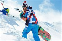 Female snowboarder in snow Stock Photo - Premium Royalty-Freenull, Code: 649-06844056