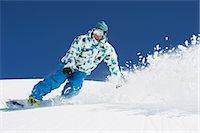 Male snowboarder in action Stock Photo - Premium Royalty-Freenull, Code: 649-06844070