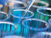 Analytical chemistry - sample being pipetted into test tube for analysis in laboratory Stock Photo - Premium Royalty-Freenull, Code: 649-06844079