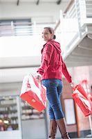 people on mall - Young woman carrying shopping bags Stock Photo - Premium Royalty-Freenull, Code: 649-06844179