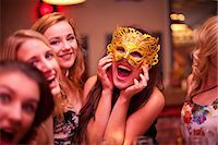 Young woman wearing masquerade mask at hen party Stock Photo - Premium Royalty-Freenull, Code: 649-06844386