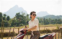 Woman on moped, Vang Vieng, Laos Stock Photo - Premium Royalty-Freenull, Code: 649-06844477