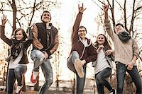 female crotch - Five teenagers fooling around, jumping in park Stock Photo - Premium Royalty-Freenull, Code: 649-06844610