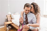 Mid adult couple face to face with arm around, smiling and holding shoe Stock Photo - Premium Royalty-Freenull, Code: 649-06844747