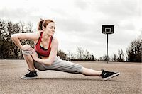 right - Woman stretching left leg and bending right leg on court Stock Photo - Premium Royalty-Freenull, Code: 649-06844931