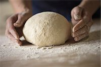 Close up of hands shaping bread dough Stock Photo - Premium Royalty-Freenull, Code: 649-06845219