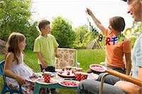 Family with two children celebrating birthday outdoors Stock Photo - Premium Royalty-Freenull, Code: 649-06845258