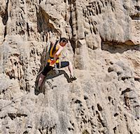 Female rock climber on rock face Stock Photo - Premium Royalty-Freenull, Code: 649-06845287