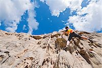 rock climber - Female rock climber nearing cliff top Stock Photo - Premium Royalty-Freenull, Code: 649-06845288