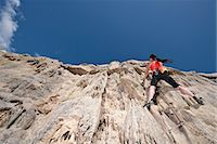 Female rock climber nearing cliff top Stock Photo - Premium Royalty-Freenull, Code: 649-06845292